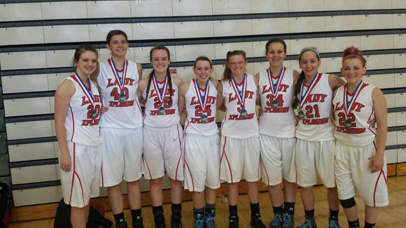 The Lady Xplosion 11th/12th grade girls basketball team.