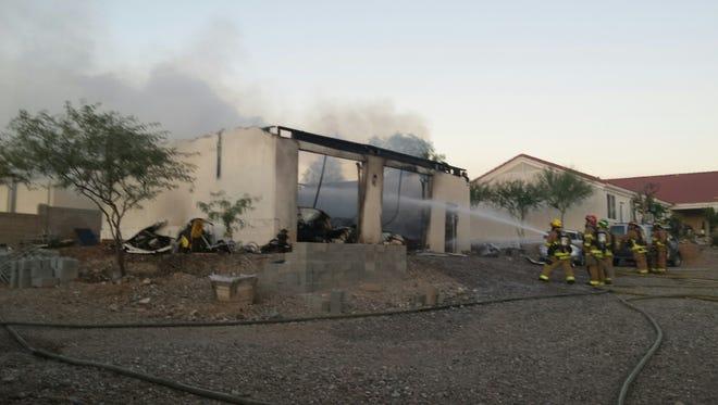 Firefighters responding to garage fire near Peoria on Sunday, Nov. 1, 2015.