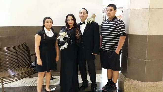 "This photo was submitted by Albert Lagunas, the winner of the 2015 Halloween photo contest. Lagunas submitted a photo of his family dressed as the ""Addams Family."""