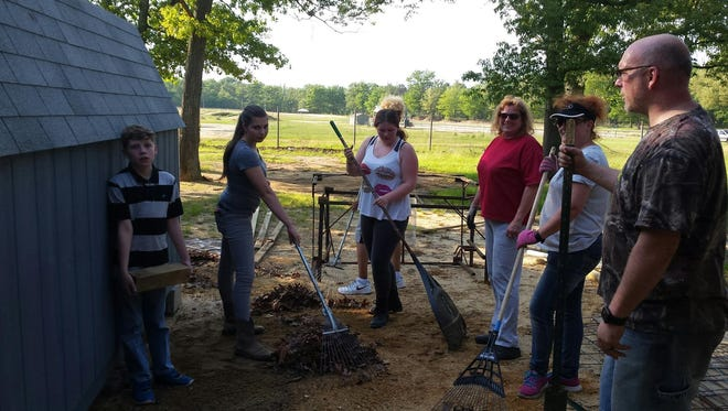 4-H members, leaders and volunteers gathered recently to clean up the Cumberland County Fairgrounds.