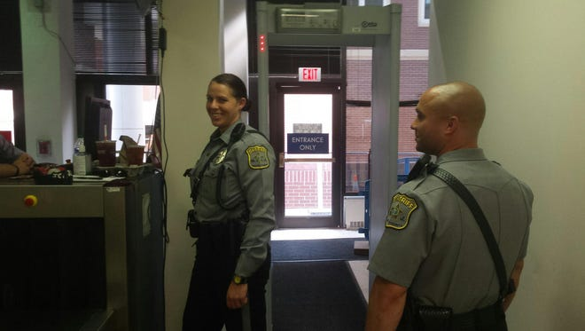 Ocean County sheriff's officers guard an entrance into the county courthouse in Toms River in this undated photo.