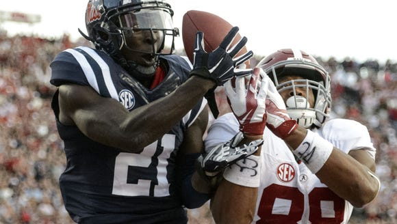 VASHA HUNT/AL.COM/AP Ole Miss defensive back Senquez