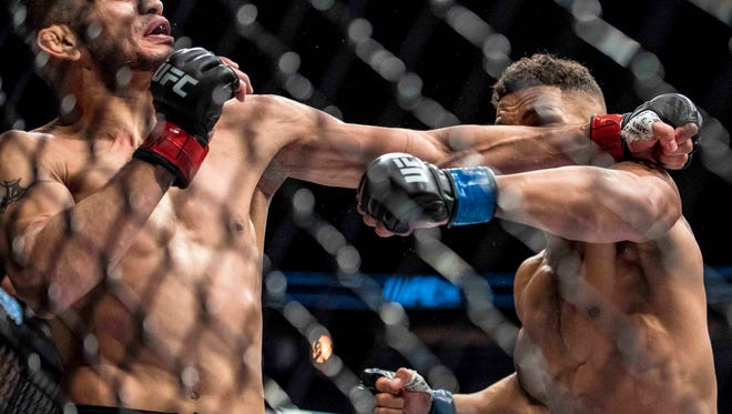 Tony Ferguson, left, lands a punch against Kevin Lee during the first round of their UFC 216 fight in Las Vegas on Saturday night.