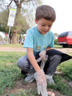 Bivins Elementary School student Hayden Jones was among the volunteers participating in Saturday's National CleanUp Day event in Amarillo.