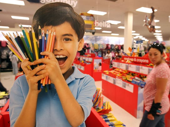A customer shops for back to school supplies at a Target