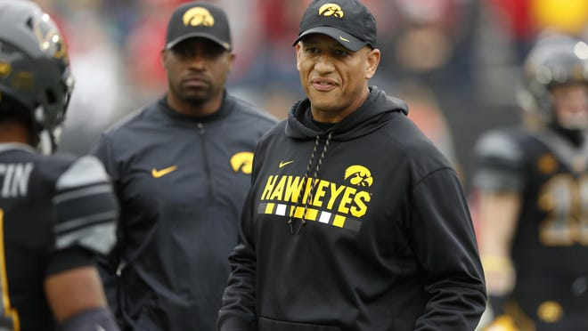 Iowa tight ends coach Levar Woods stands on the field before an NCAA college football game against Ohio State, Saturday, Nov. 4, 2017, in Iowa City, Iowa.