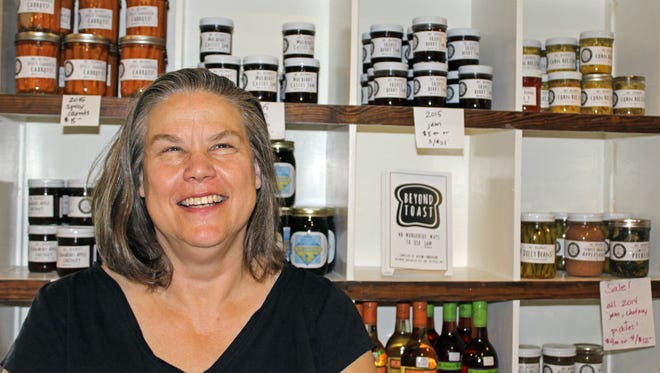 Alline Anderson sells jams, pickled vegetables and other products made with food harvested at Dancing Rabbit Ecovillage.