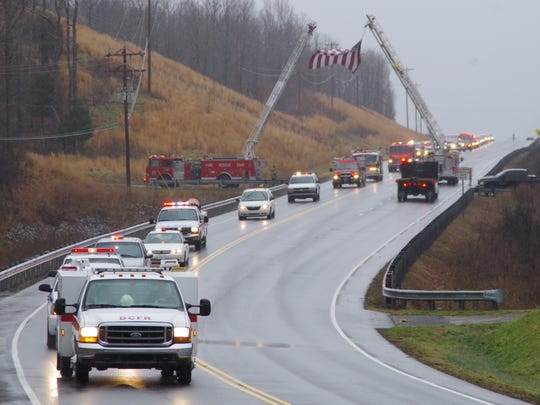 Funeral procession on Highway 70 West for Johnny Tummins.
