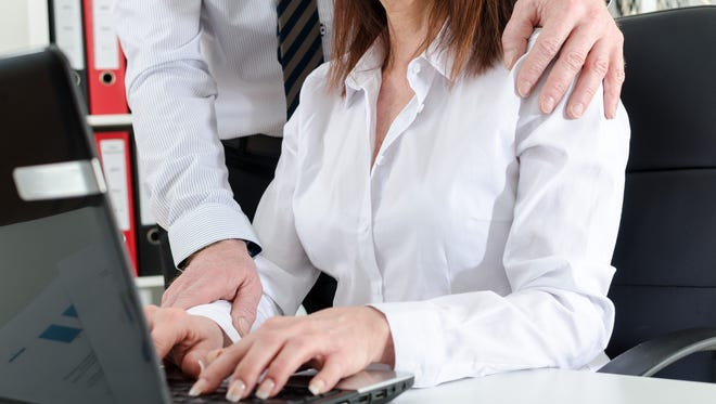 Photo illustration of sexual harassment at work.