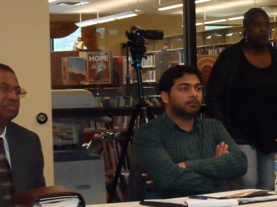 Celeta McCall (right) listens during an EPA-sponsored
