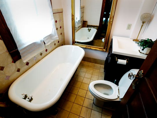 The five bed, two bath house built in 1906 at 1716 North Parkway, features clawfoot bathtubs that are original to the home. The house was the first one built on North Parkway.