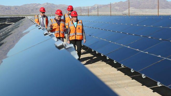 Interior Secretary Sally Jewell, right, tours the 550-megawatt Desert Sunlight solar plant east of the Coachella Valley.