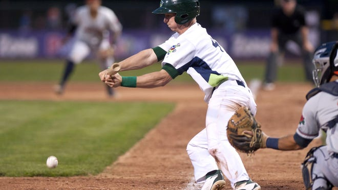 Vermont Lake Monsters shortstop Kevin Merrell attempts a bunt against the Connecticut Tigers during a recdnt game at Centennial Field.