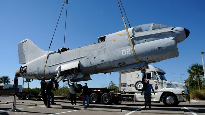 A-7 Corsair being unloaded at the Brevard Veterans Memorial Center and Museum