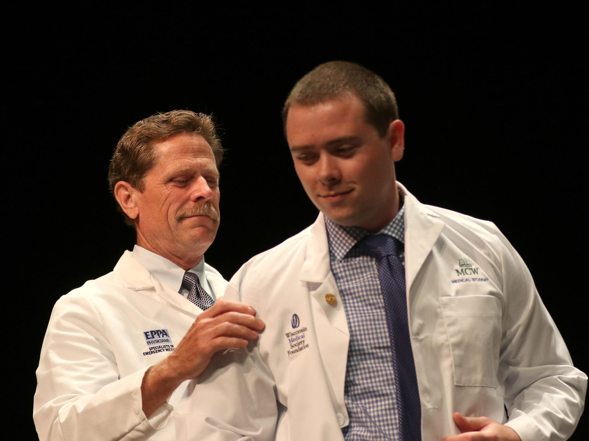 John Frawley is coated during the Medical College of Wisconsin Central Wisconsin White Coat Ceremony at UW Marathon County, in Wausau, Wisconsin, July 7, 2016.
