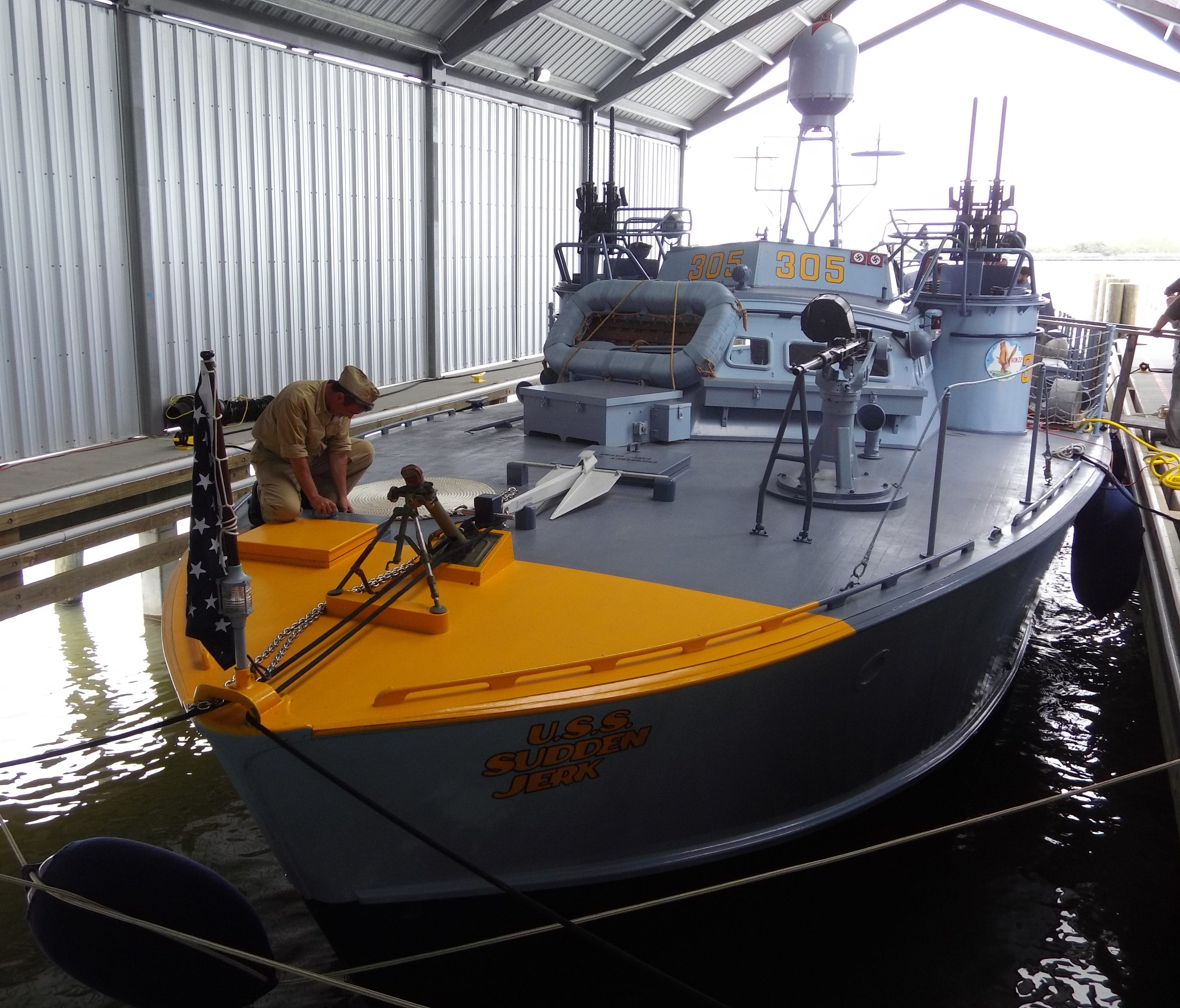 On a recent Friday afternoon on New Orleans' Lake Pontchartrain, PT-305 sat quietly in her boathouse, not giving any inclination as to what she saw in the Mediterranean during World War II, for which she was commissioned in December 1943 and tested o