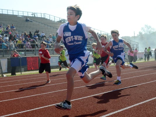ANI Rapides Parish Fitness Meet Ruby Wise Elementary School student Hunter Lavespere takes first in his heat in the 50-year dash at the Rapides Parish Fitness Meet held Wednesday, March 25, 2015 at Alexandria Senior High School.-Melinda Martinez/mmartinez@
