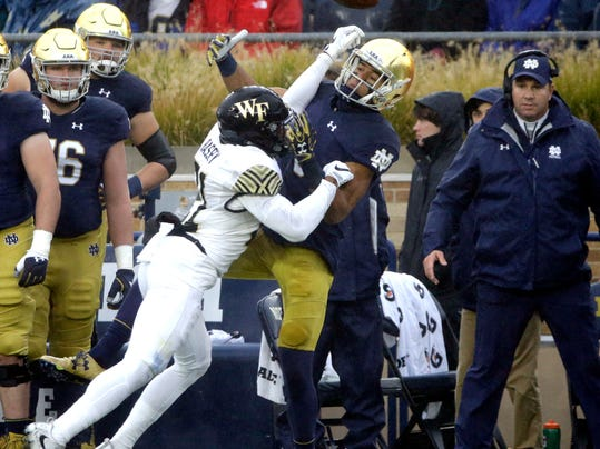 Notre Dame wide receiver Equanimeous St. Brown, center right, cannot make a catch against Wake Forest defensive back Essang Bbadey during the first half of an NCAA college football game Saturday, Nov. 4, 2017, in South Bend, Ind. (AP Photo/Nam Y. Huh)