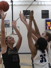 Marian's all-league junior guard Olivia Moore (12) netted a game-high 17 points in Friday's Class A district championship game victory over Royal Oak.