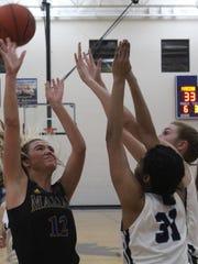Marian's all-league junior guard Olivia Moore (12)