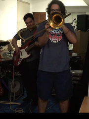 "From left to right, Doug Chan, saxophone; Bryan Padua, bass guitar; and Jeremy Bevacqua, trombone. Members of Fat Tofu live in the studio, playing ""9 to 5,"" which is one out of the four songs available in there new extended play."