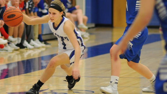 Cedar Crest's Gracen Donmoyer dribbles around Cocalico guard Emily Fassnacht during the Falcons' 51-35 victory over Cocalico in the L-L tournament first round Monday.