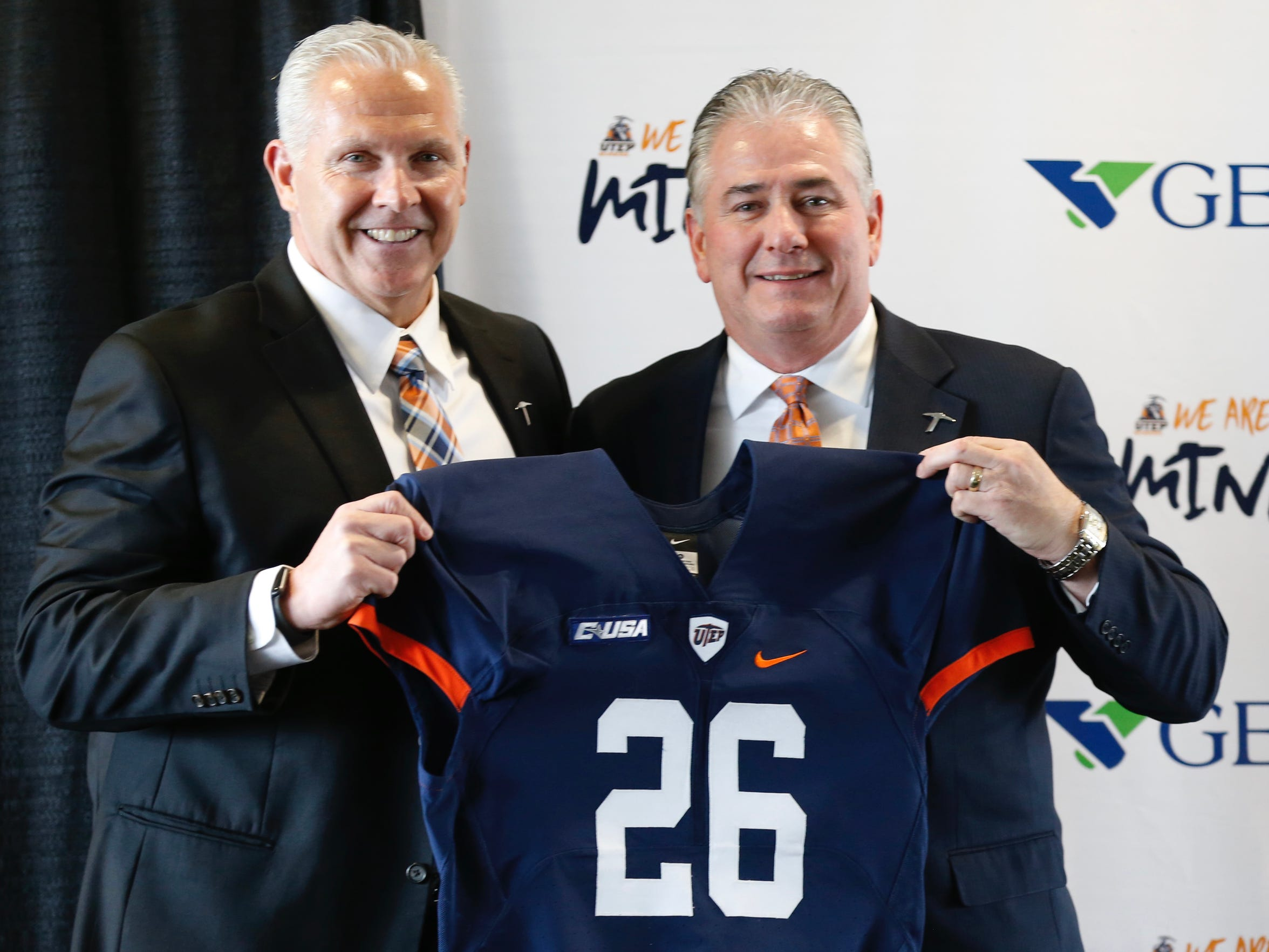 Director of UTEP Athletics Jim Sentor stands with new