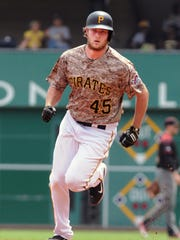 File photo from May, 26, 2016 -- Pittsburgh Pirates pitcher Gerrit Cole rounds the bases after hitting a three run home run in the second inning against the Arizona Diamondbacks in Pittsburgh.
