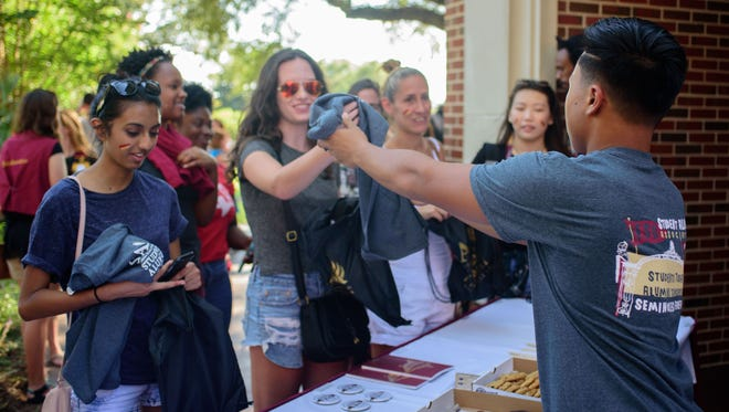 New and returning students attend the Florida State University Student Alumni Association Annual BBQ at the SAA house, on Thurs., Aug. 25, in Tallahassee, FL.