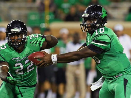 North Texas quarterback DaMarcus Smith (10) fakes the hands off to running back Antoinne Jimmerson (22) during a game against Western Kentucky.