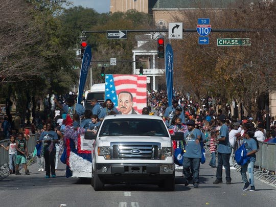Civic organizations, businesses and private citizens march along the parade route to honor and celebrate the memory of Martin Luther King, Jr. in downtown Pensacola during the 2017 parade.
