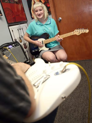 Joni Lemons works with her guitar teacher, Jason Spell, at Springfield Music on July 15, 2015.