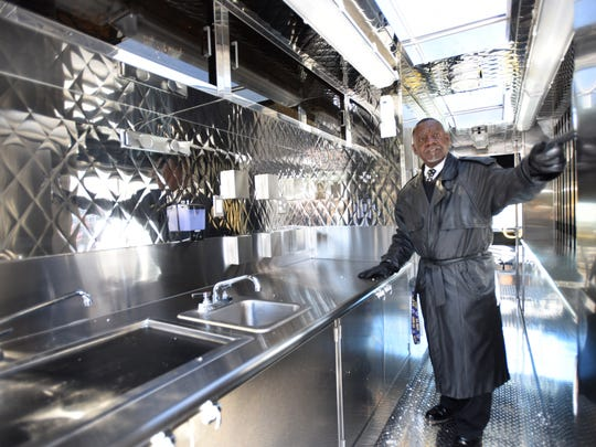 James Trower, supervisor of Child Nutrition for the Capital School District in Dover, looking over the interior of new food truck for The Capital School District. The truck will be in the community to provide free meals for the summer food program.