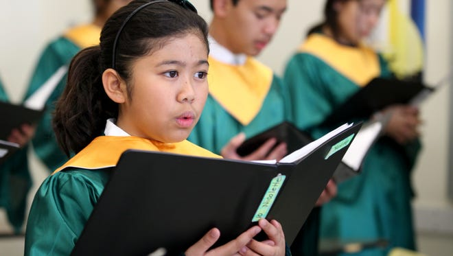 Student, Nicolette Jimenez rehearses in the St. Helena Pueri Cantores Choir under the direction of Maria Leonor Llorin, (music director) at St. Helena School in Edison, NJ, November 23, 2015. The choir will be traveling to Rome to be part of a choir singing for Pope Francis.