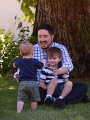Brett McGinness with sons George (4) and Joey (1).