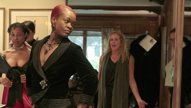 Designer Meghan Mundy likes the look as model Kaydian Hayle of Rochester tries on outfits in preparation for Fashion Week 2015.