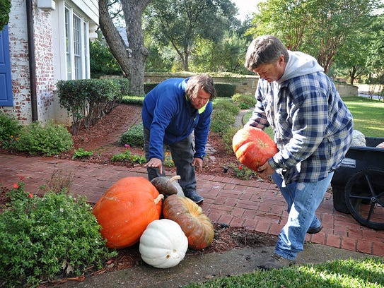 """Kevin """"The Pumpkin Man"""" Parks, right, and his helper,"""