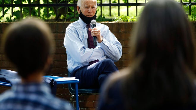 Democratic presidential candidate, former Vice President Joe Biden, center, speaks to Stacie Ritter, right, and her son, Jan, during a meeting with families who have benefited from the Affordable Care Act, Thursday, June 25, 2020, in Lancaster, Pa. (AP Photo/Matt Slocum)