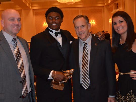 Dream Team award winner Brandon Randle with Lorin and Audra Granger, and Michigan State coach Mark Dantonio during the 2015 Detroit Free Press Football Awards Banquet on Sunday, December 13, 2015, in Dearborn, MI.