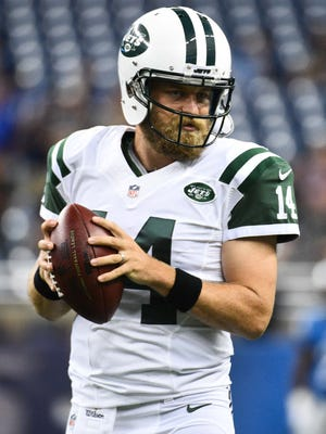 New York Jets quarterback Ryan Fitzpatrick (14) warms up before the preseason NFL football game against the Detroit Lions at Ford Field.