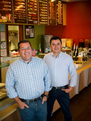 Abraham Brown, left, and Ezequiel Campos, both of Henderson, co-owners of La Campirana. They recently opened a second location in Henderson, Kentucky.