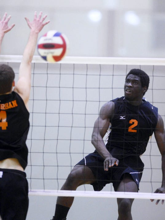 Central York's Jeremiah Dadeboe hits against York Suburban's Ian Firestone during a boys' volleyball match in March at Central York High School. The Panthers, Trojans, Northeastern and Dallastown will be a part of Saturday's Koller Classic.