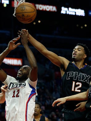 Phoenix Suns forward TJ Warren, right, blocks a shot