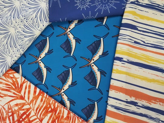 Sailfish, sailing regattas and sunsets factor into the Resort at Home's Stuart line of fabric designs has sailfish, sailing regattas and sunsets.