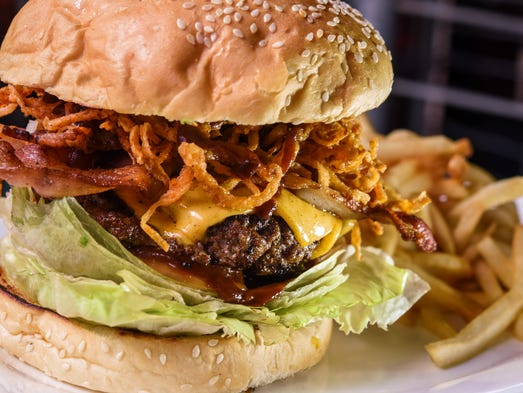 The Q Burger, made with bacon, crispy tangled onions,