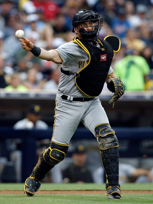 Pittsburgh Pirates catcher Francisco Cervelli throws out San Diego Padres' Jabari Blash at first base after a strikeout during the fourth inning of a baseball game in San Diego, Saturday, July 29, 2017. (AP Photo/Alex Gallardo)