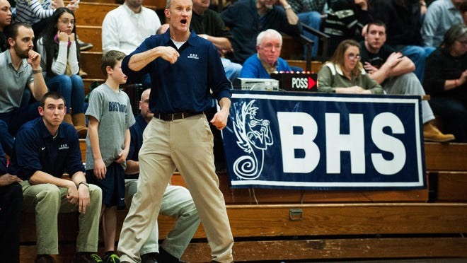 Burlington head coach Matt Johnson talks to his tema on the court during the boys basketball game between the Rice Green Knights and the Burlington Seahorses at BHS high school on Tuesday night December 9, 2014 in Burlington, Vermont.