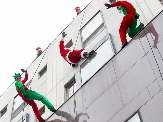 Following Ithaca tradition, Santa rappels onto  The
