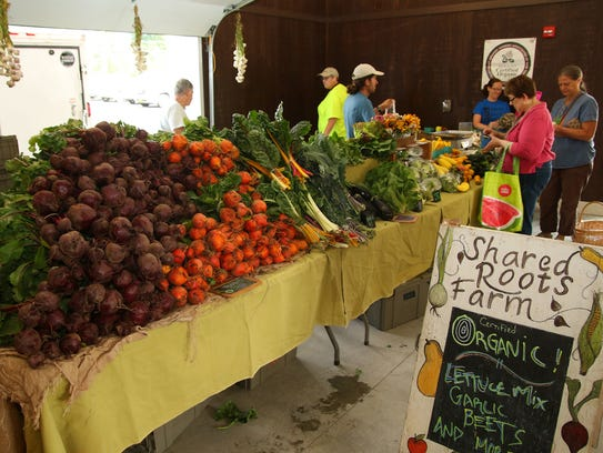 Shared Roots Farm displays produce for sale Saturday