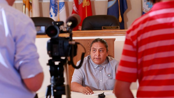 Gary Mike speaks during a press conference on Thursday at the San Juan Chapter house in Lower Fruitland. His 11-year-old daughter, Ashlynne Mike, was kidnapped and killed last week.